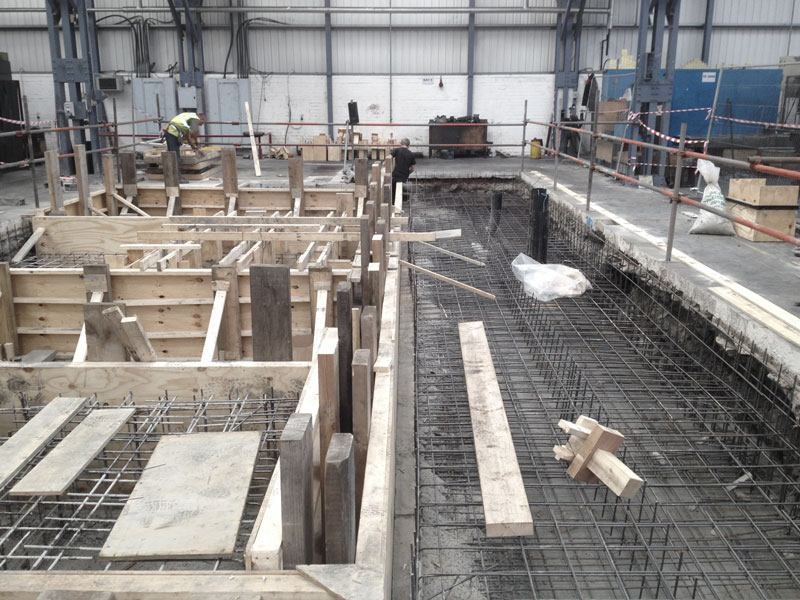 Machine base, concrete, rebar, timber formwork