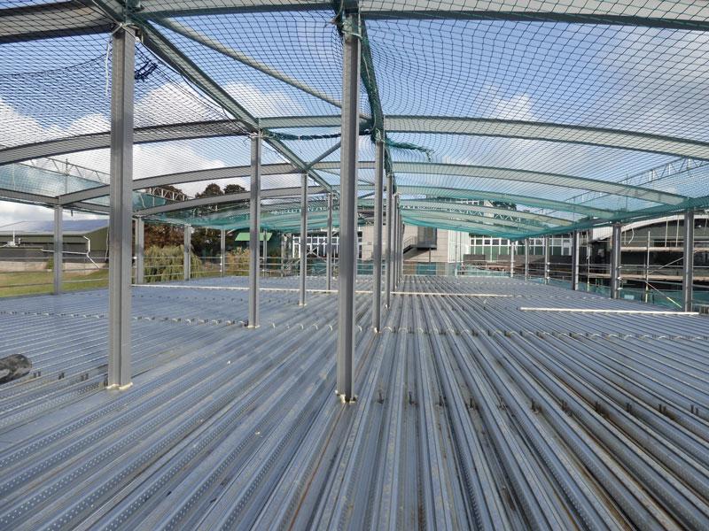 Steel frame, metal deck, concrete pour